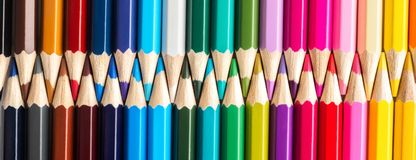 Set of colored pastel pencils in row multi color in form of closed zipper royalty free stock photo
