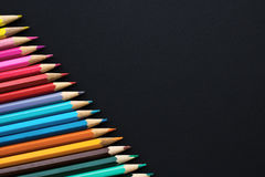 Set of colored pencils on a black background - copy space Royalty Free Stock Photography