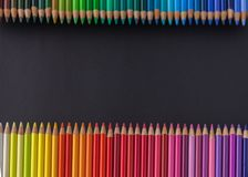 Set Of Colored Pencils of cold tones On A Black Background. Mock-up stock images