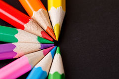 A set of colored pencils on a dark background Stock Images