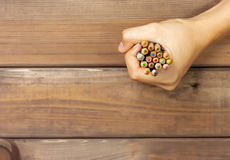 Set of colored pencils in female hands on a background of dark w Royalty Free Stock Images