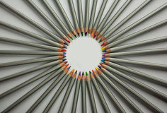 Set of colored pencils isolated against the white background. Rays of pencils. top view, close up Stock Photo