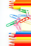 Set of colored pencils and paper clips Stock Images