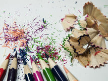 Set of colored pencils. Sharpened, sharp,nWith shavings from the sharpenernabstract royalty free illustration