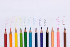 Set of colored pencils on a sheet of paper . Set of colored pencils on a sheet of paper Royalty Free Stock Images