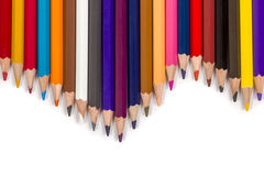 Set of colored pencils in wave shape. Set chiseled of colored pencils located next to each other on a white background Stock Images