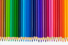 Set of colored pencils on white table Stock Photos