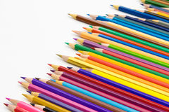 Set of colored pencils on white table. Isolated Stock Photo