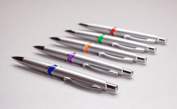 Set of colored pens on table Stock Photos