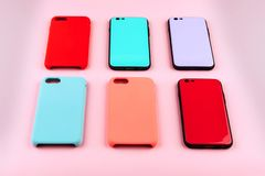 Set of colored silicone covers for smart phone stock images