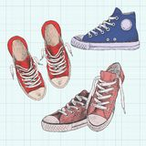 Set of colored sneakers. Hand drawn illustration. Gumshoes on a background of a sheet of paper. Set of colored sneakers. Hand drawn illustration. Gumshoes stock illustration