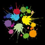 A set of colored stains. Caused by falling liquid on a black background Stock Photos