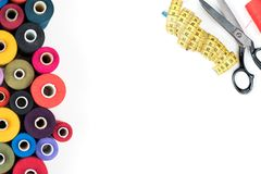 Colored thread coils isolated on white background, sewing supplies, text ready, banner, book or magazine cover. Set of colored thread coils, black scissors and Royalty Free Stock Image