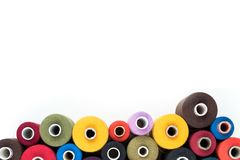 Colored thread coils isolated on white background, sewing supplies, text ready, banner, book or magazine cover Royalty Free Stock Image