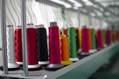 Set of colored threads for sewing on coils. stock image