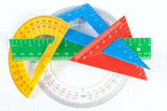 A set of colored triangles and lines protractors for drawing. Royalty Free Stock Images