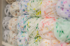 A set of colored yarn. A set of skeins of colored yarn stock photo