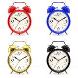 Set of 4 colorful alarm clocks Stock Image
