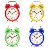 Set of 4 colorful alarm clocks. Set of 4 alarm clocks isolated on white background. Vintage style red, blue, green, yellow clock. Graphic design element for Royalty Free Stock Photo
