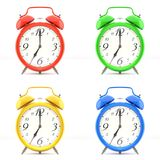 Set of 4 colorful alarm clocks. Set of 4 alarm clocks  on white background. Vintage style red, blue, green, yellow clock. Graphic design element for flyer Stock Photos