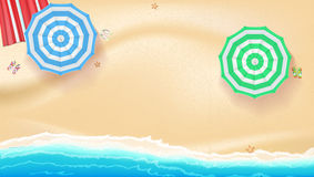Set of colorful beach umbrellas on the background a sand near the sea surf Stock Photography
