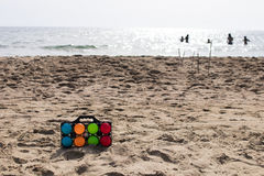 Set of colorful bowls for beach game Stock Photo