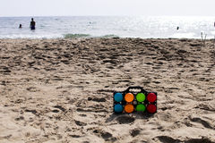 Set of colorful bowls for beach game. Set of colorful bowls for beach play with the sea in the background Royalty Free Stock Image