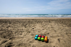 Set of colorful bowls for beach game at sea Royalty Free Stock Photos