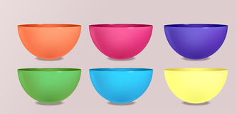 Set of colorful bowls and cups. Royalty Free Stock Photo