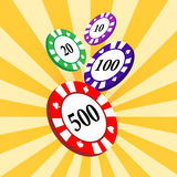 Set of colorful casino chips on a yellow radial background. Stock Photography