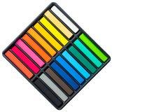 Set of colorful chalk stick on black tray Royalty Free Stock Photo