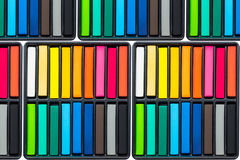 Set of colorful chalk stick on black trays Stock Images