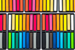 Set of colorful chalk stick on black trays Royalty Free Stock Photo