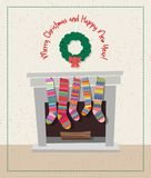 Set of colorful christmas stockings hanging. Cute holiday card with set of colorful christmas stockings hanging on the fireplace Royalty Free Stock Images