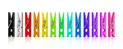 Set of colorful clothes pins. Front view. On white background Royalty Free Stock Photo