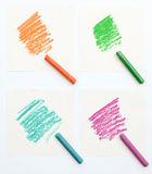 Set of colorful crayons on piece of white paper Stock Photography