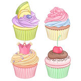 A set of colorful cupcakes isolated on white background. Stock Image