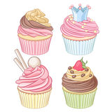 A set of colorful cupcakes isolated on white background. A set of colorful cupcakes. Vector illustration isolated on white background Royalty Free Stock Images