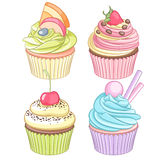 A set of colorful cupcakes isolated on white background. A set of colorful cupcakes. Vector illustration isolated on white background Stock Photography