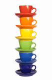 Set of colorful cups. Colored tea cups and saucers, isolated on white Stock Photos