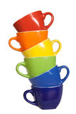 Set of colorful cups. Multi colored tea cups and saucers, isolated on white Royalty Free Stock Image