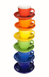 Set of colorful cups. Multi colored tea cups and saucers, isolated on white Royalty Free Stock Photos