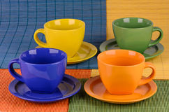 A set of colorful cups with plates Stock Photos