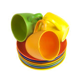 Set of colorful cups and saucers Stock Image