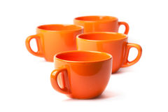 Set of orange cups on white background Royalty Free Stock Photography