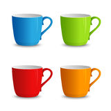 Set of colorful cups on a white background Royalty Free Stock Image