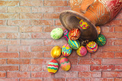 Set of colorful easter egg with clay jar on brown brick wall Royalty Free Stock Image
