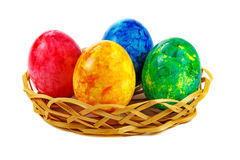 Set of colorful Easter eggs in basket on a white background Royalty Free Stock Images