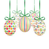 Set of colorful Easter eggs with green ribbons Stock Photography