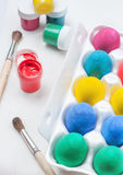 Set of colorful Easter eggs. Jars of paints and brushes Royalty Free Stock Photography